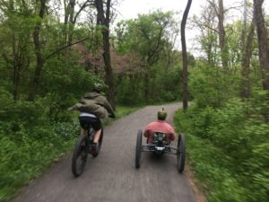 Two men on bicycles, one on mountain bike, one on an adaptive cycle, ride the Union Canal Trail at Gring's Mill Park in Pennsylvania's Americana Region.